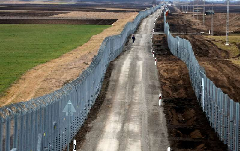 A Hungarian policeman patrols the Hungary-Serbia border, which was recently fortified by a second fence, near the village of Gara, Hungary, March 2, 2017. a REUTERS/Laszlo Balogh