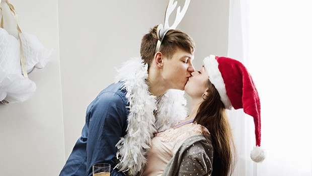 christmas-party-cheating-kiss-665392
